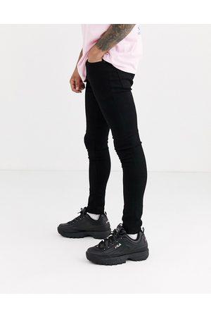 ASOS DESIGN spray on jeans in power stretch denim in black