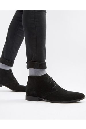 ASOS DESIGN chukka boots in black faux suede