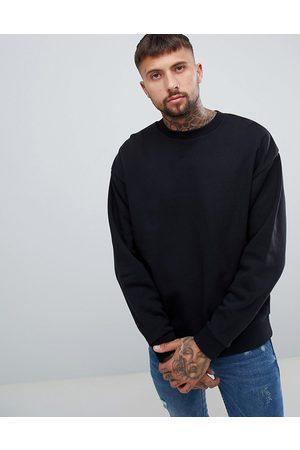 ASOS DESIGN oversized sweatshirt in black