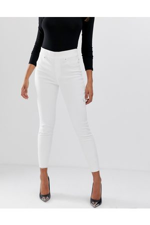 Spanx shape and lift distressed skinny jeans-White