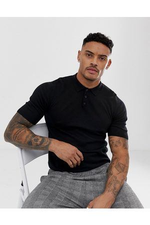 ASOS DESIGN knitted muscle fit polo shirt in black