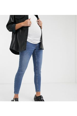 Topshop Maternity Jamie overbump skinny jeans in mid wash-Blue
