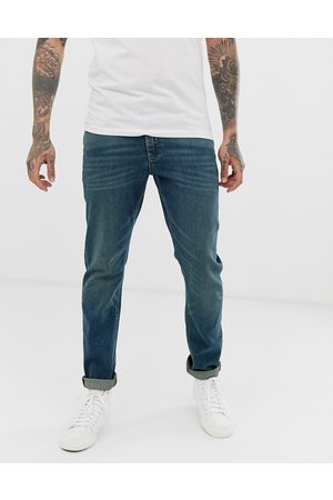 ASOS DESIGN stretch slim jeans in vintage dark wash blue