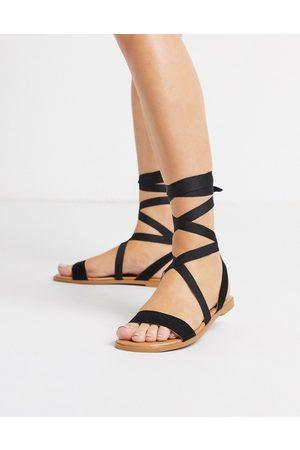 ASOS Finland tie leg flat sandals in