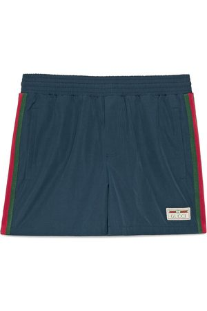 Gucci Waterproof nylon swim shorts with Web
