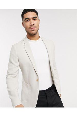 ASOS DESIGN super skinny blazer in stone waffle jersey