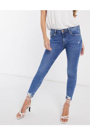 River Island Amelie raw hem skinny jeans in mid wash-Blue