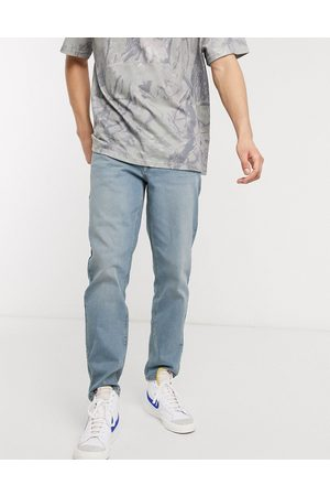 ASOS DESIGN stretch tapered jeans in light wash blue