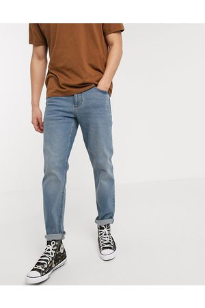 ASOS DESIGN stretch tapered jeans in mid wash blue