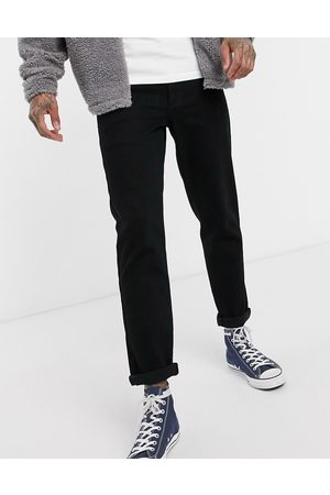 ASOS DESIGN stretch tapered jeans in black