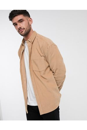 ASOS DESIGN oversized 90's style cord shirt in beige