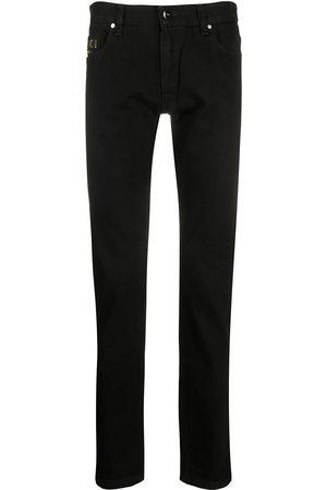 Fendi Men Slim - Embroidered logo slim-fit jeans