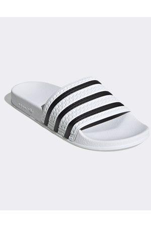 Thongs - Adidas Originals adilette sliders in white and black