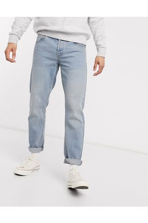 ASOS DESIGN tapered jeans with dusty tint-Blue