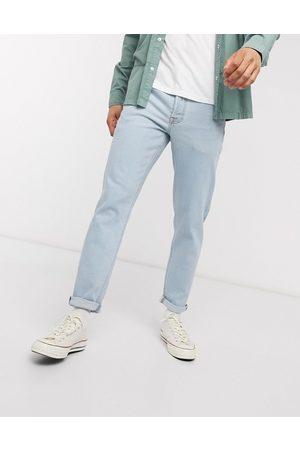 ASOS DESIGN tapered jeans in light wash-Blue