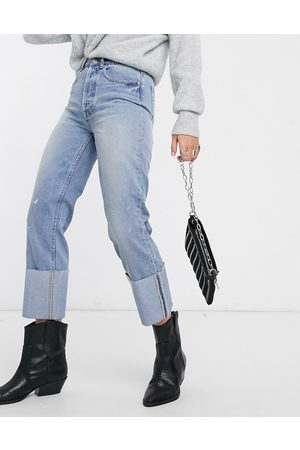 Only straight leg jeans with turn up hem detail in light blue wash