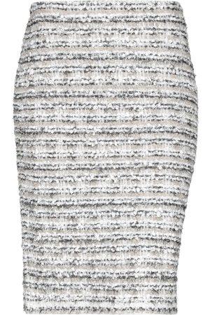 D.EXTERIOR Knee length skirts