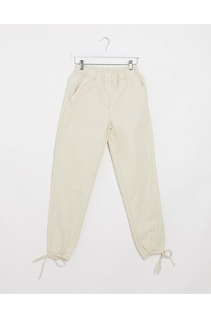 ASOS DESIGN tie cuff jogger in cream-Green