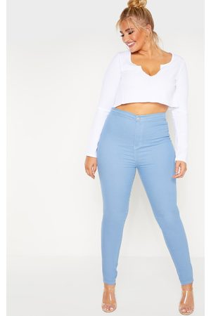 PRETTYLITTLETHING Plus Mid Wash Stretch Jegging