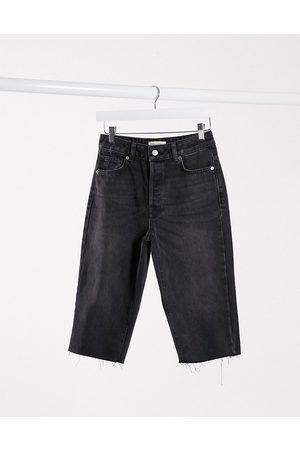 Selected Femme longline denim shorts with raw hem in black
