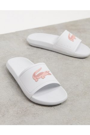 Lacoste Thongs - Croco logo slides in white and pink