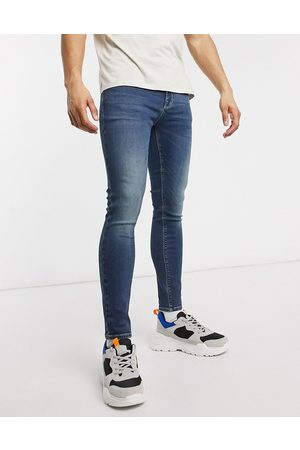 ASOS Spray on jeans with power stretch in dark wash blue