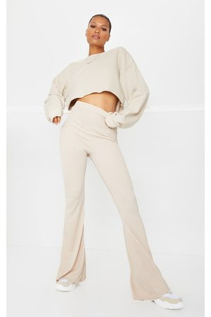 PRETTYLITTLETHING Stone Ribbed Flared Pants