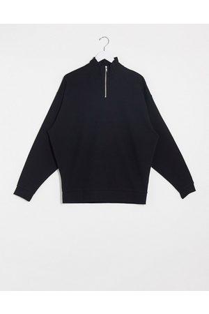 ASOS Oversized half zip sweatshirt in black