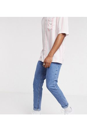 COLLUSION X003 tapered jean in stonewash blue