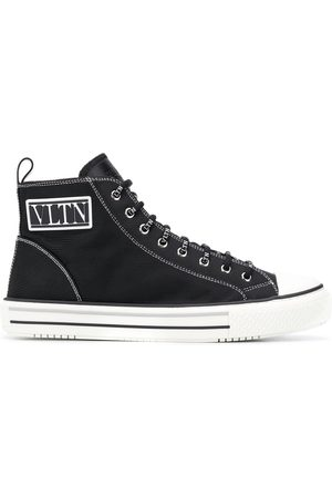 VALENTINO GARAVANI VLTN patch high-top sneakers