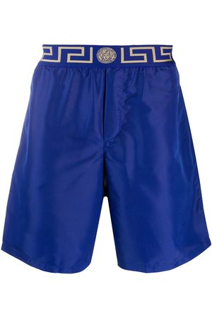 VERSACE Men Board Shorts - Greca Border knee-length swim shorts