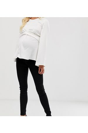 ASOS ASOS DESIGN Maternity Tall high rise ridley 'skinny' jeans in clean black with over the bump waistband