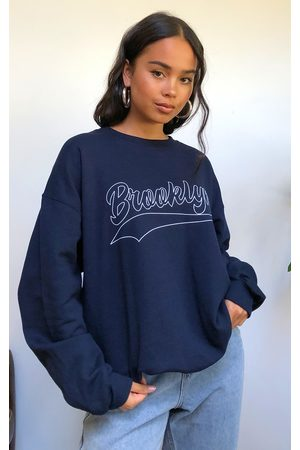 PRETTYLITTLETHING Navy Brooklyn Slogan Sweatshirt
