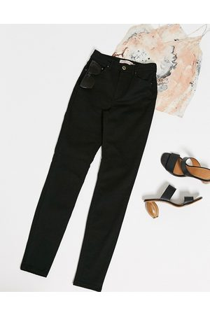 Pieces Nora high waisted skinny jeans in black