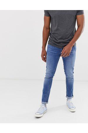 Jack & Jones Intelligence Glenn slim tapered fit jeans in light blue
