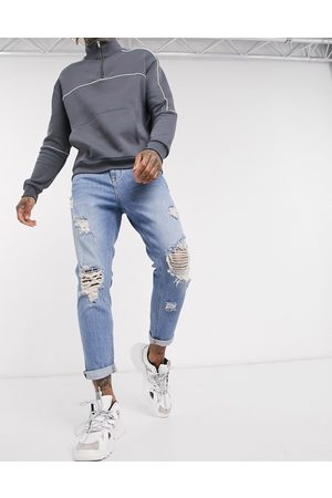 ASOS Tapered - Tapered carrot jeans in vintage light wash with heavy rips-Blue