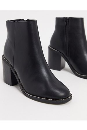 ASOS Rising heeled boots in black