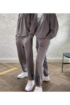 PUMA Oversized trackies in washed charcoal - exclusive to ASOS-Grey
