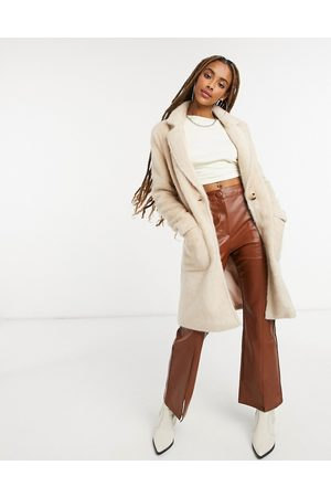 Only Faux-fur longline coat with pocket detail in cream