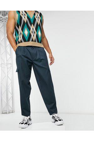 ASOS Cargo oversized tapered smart pants in navy