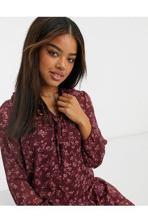 New Look Frill neck chiffon smock mini dress in purple floral