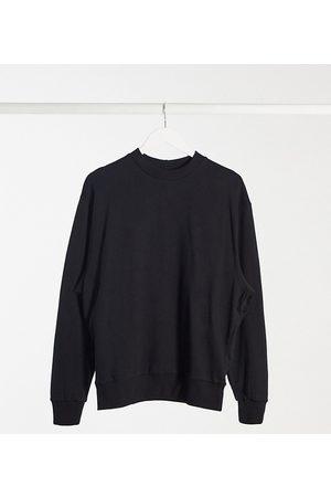 COLLUSION Unisex sweatshirt in black