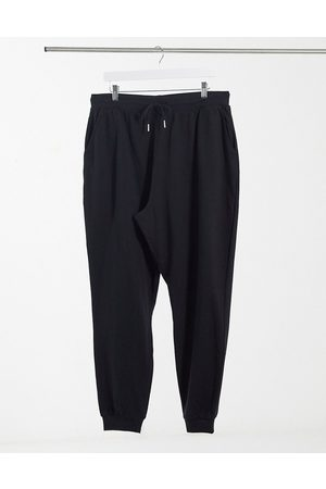 ASOS Basic trackies with tie in organic cotton in black