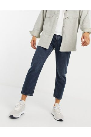 ASOS Relaxed tapered jeans in blue black wash