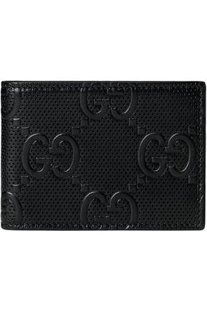 Gucci Men Wallets - GG embossed bi-fold wallet