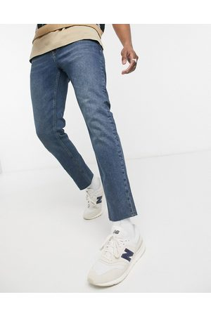 ASOS Stretch slim jeans in tinted mid blue with raw hem