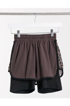 South Beach Fitness double layer side print panel shorts in brown with earthy leopard print