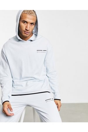 ASOS Unrvlld Supply ASOS Unrvlld Spply co-ord oversized hoodie with rubber logo-Blue