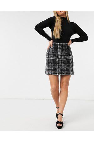 Forever New Women Printed Skirts - Boucle mini skirt in monochrome check-Multi
