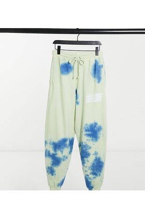 COLLUSION Unisex oversized trackies with print in tie dye-Multi